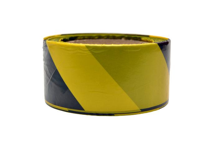 Advarselsbånd i gule og sorte farver